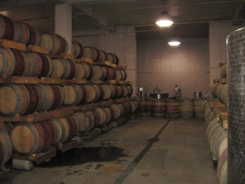 Wine barrels at Chateau des Charmes, red on othe left and white on the right