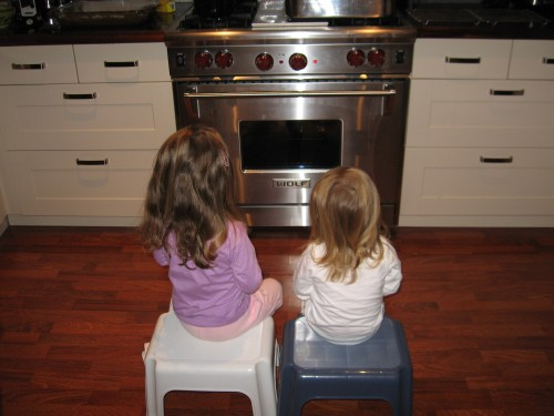 Sienna and Madison waiting for the cookies to be done. Longest 15 minutes of their lives.