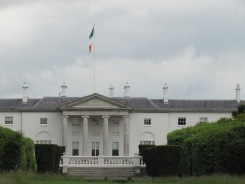 The light you see in the window between the first and second columns is lit to represent the president's wish for peace in Ireland.