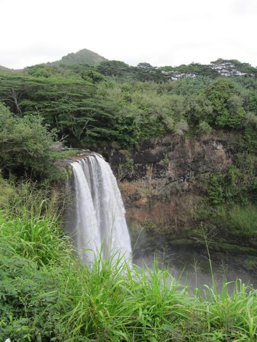 Wailua Falls where a local craft vendor enjoyed driving golf balls into the water while waiting to make his next sale